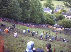Competitors in the annual cheese rolling race on Cooper's Hill