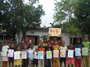Children holding up letters to make the name Keith Prosser