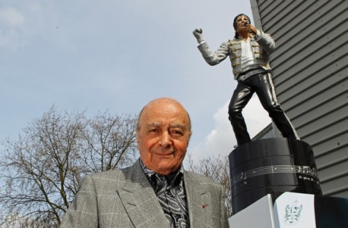 Mohamed Al Fayed infront of statue of Michael Jackson